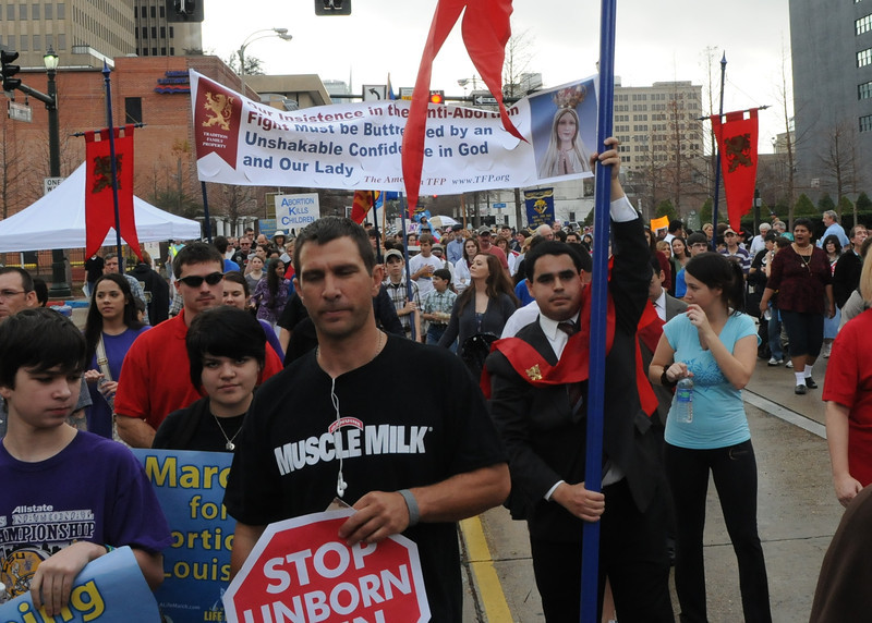 TFP member Cesar Franco carries the 20 ft. tall TFP campaign standard during the Louisiana Life March