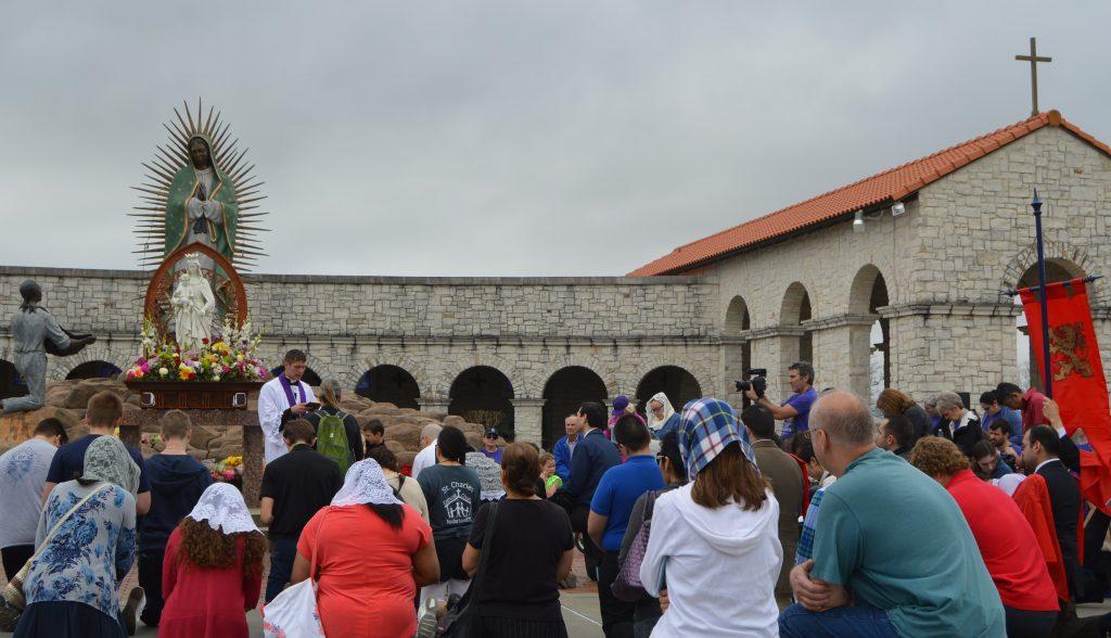 Penitent Catholics recieve a blessing from Fr. John Kodet